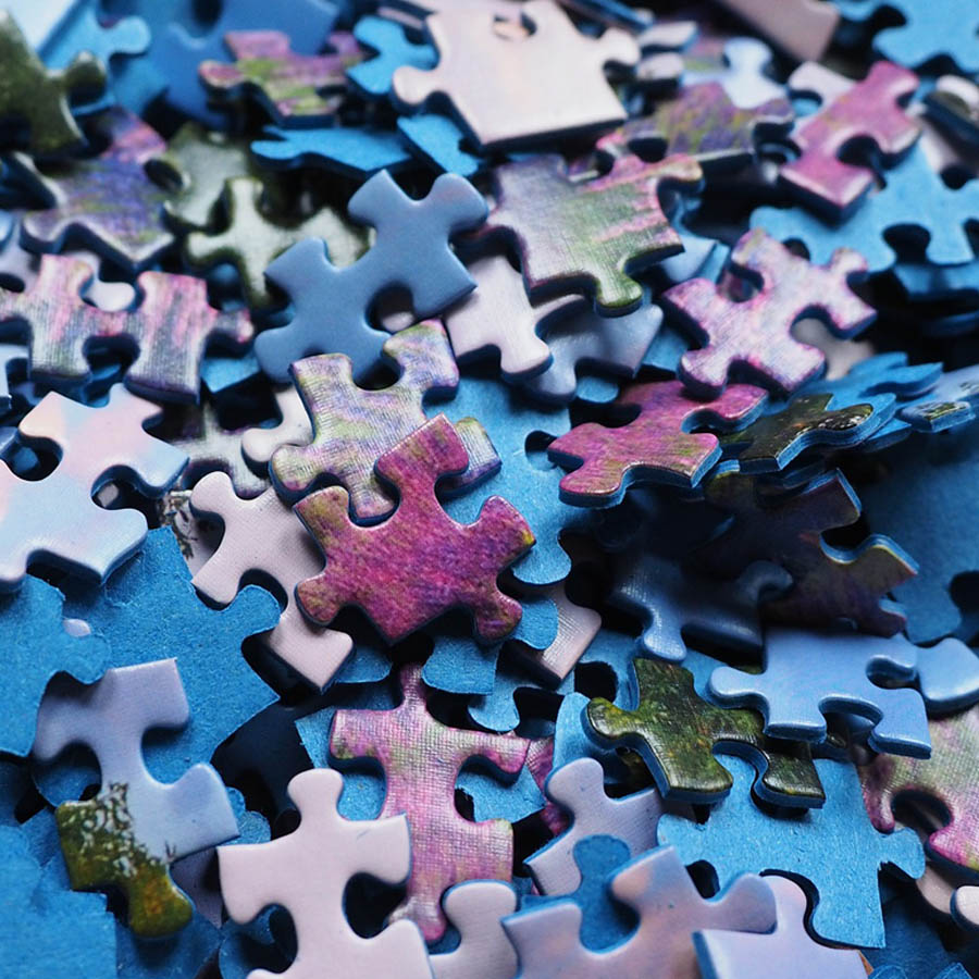 Photo of a bunch of puzzle pieces piled on top of one another