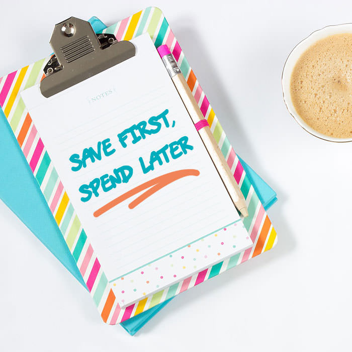 Photo of a colorful clipboard that says Save first, Spend later