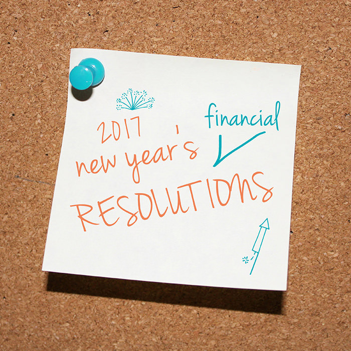 Post-it note pinned to a bulletin board that says 2017 new years resolution - There is an arrow pointing between new years and resolution that says financial indicating it should be 2017 new years financial resolutions
