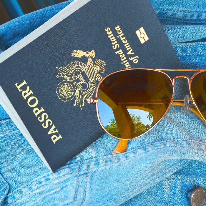 Photo of a passport and sunglasses